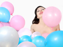 Beautiful woman surrounded by balloons Royalty Free Stock Images