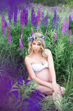 Beautiful woman  surrounded by flowers field Royalty Free Stock Photography