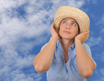 Beautiful woman surrounded by sky. Royalty Free Stock Photos