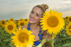 Beautiful woman surrounded by sunflowers Stock Photo