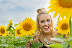Beautiful woman surrounded by sunflowers.  Royalty Free Stock Photos
