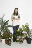 Beautiful Woman Surrounded By Various Potted Plants Stock Photos