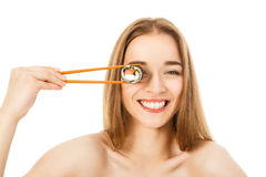 Beautiful woman with sushi and chopsticks. Beautiful girl with sushi and chopsticks isolated Royalty Free Stock Photography