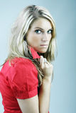 Beautiful woman with a suspicious angry look Royalty Free Stock Photo