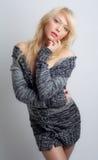 Beautiful Woman in Sweater Dress Stock Photography