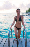 Beautiful woman swim. Beautiful swimmer climbs ladder after swim in ocean vacation stock photography