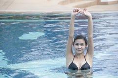 Beautiful woman in swimming pool. Stock Photography