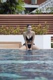 Beautiful woman in swimming pool. Stock Photo