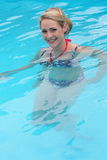 Beautiful woman swimming in a pool Royalty Free Stock Photos