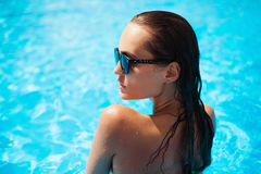 Beautiful model in a swimming pool royalty free stock photo