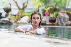 Beautiful Woman Swimming Pool At Resort Relaxed Portrait Young Asian Girl Royalty Free Stock Photography