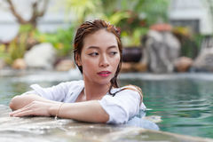 Beautiful Woman Swimming Pool At Resort Relaxed Portrait Young Asian Girl Royalty Free Stock Image