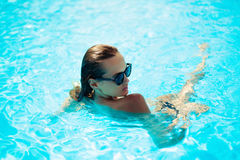 Beautiful woman in a swimming pool royalty free stock photography