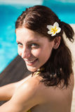 Beautiful woman by swimming pool on a sunny day Royalty Free Stock Images