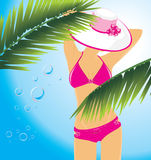 Beautiful woman in a swimming suit among the palms Stock Photography