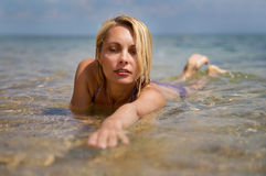 Beautiful woman swims in the sea Royalty Free Stock Photography