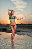 Beautiful woman in a swimsuit on the beach Royalty Free Stock Image