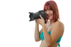 Beautiful woman in swimsuit holding digital photo camera Stock Images