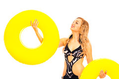 Beautiful woman in swimsuit with rubber rings Royalty Free Stock Photos