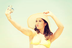 Beautiful woman in swimsuit taking selfie. Stock Images