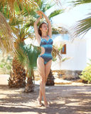 Beautiful woman in swimsuit on tropical island near palms Royalty Free Stock Image