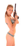 Beautiful woman in swimsuite with gun Stock Image