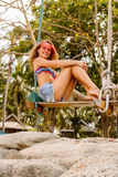 Beautiful woman on swing in tropics. Royalty Free Stock Photography