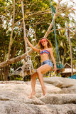 Beautiful woman on swing in tropics. Stock Photography