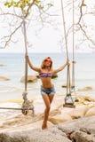 Beautiful woman on swing in tropics. Royalty Free Stock Image