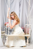 Beautiful woman on a swing Royalty Free Stock Image