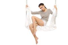 Beautiful woman swinging on a swing. Stock Photo