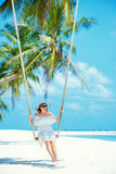 Beautiful woman swinging on a Tropical beach, Koh Phangan island. Thailand Royalty Free Stock Photos