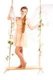 Beautiful woman swinging on white background Royalty Free Stock Photo