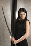 Beautiful woman with a sword Royalty Free Stock Photography