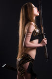 A beautiful woman with a sword Stock Images
