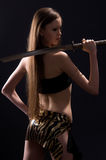 Beautiful woman with a sword in the studio Royalty Free Stock Image