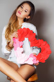 Beautiful woman with a symbol of Valentine's day. Stock Photography