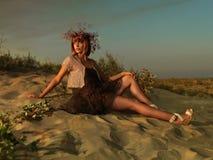 Beautiful woman t dress beach admiring sunset Stock Photo