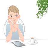 Beautiful woman with tablet computer at café Stock Image