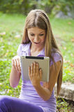Beautiful Woman With Tablet Computer In Park Stock Image