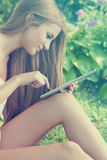 Beautiful Woman With Tablet Computer In Park Garden Royalty Free Stock Photo