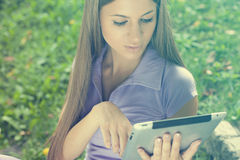 Beautiful Woman With Tablet Computer In Park Stock Photos