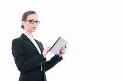 Beautiful woman with tablet in formal clothes Royalty Free Stock Photos