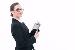 Beautiful woman with tablet in formal clothes Stock Photography