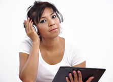 Beautiful woman, tablet and headphone Royalty Free Stock Photos