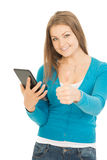 Beautiful woman with tablet shows thumb up Royalty Free Stock Photography