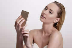 Beautiful woman take a smiling selfie with smartphone Stock Photography