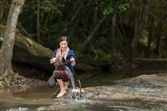 Beautiful women take some water in the river to use in daily lif. Beautiful woman take some water in the river to use in daily life at home in countryside royalty free stock photos