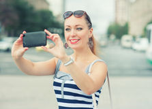 Beautiful woman taken picture of herself in the city Royalty Free Stock Image