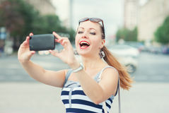 Beautiful woman taken picture of herself in the city Royalty Free Stock Photos